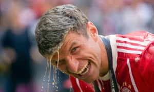 Thomas Müller is able to smile despite having just been showered in beer as Bayern celebrated their 67th German league title.