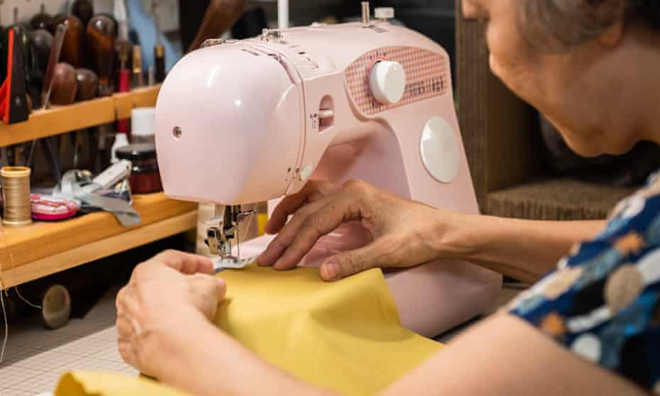 Senior woman sewing on a sewing machine
