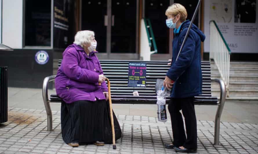 two women in face masks talking in Rochdale town centre
