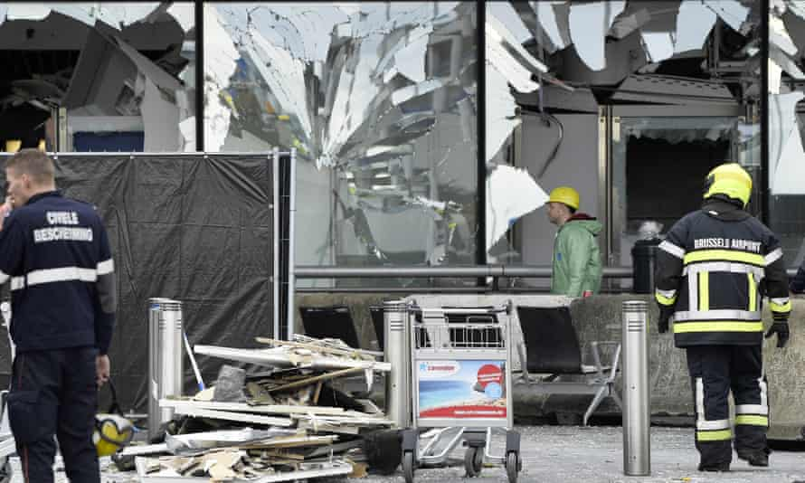 Rescue workers outside the damaged front of Brussels airport.