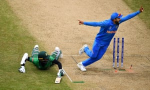 Virat Kohli of India appeals unsuccessfully for the run out of Shakib Al Hasan of Bangladesh.