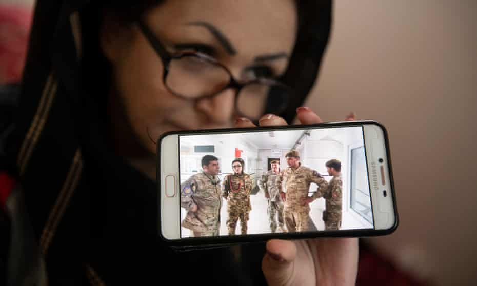 Sahar shows a photo of her taken in army uniform with colleagues