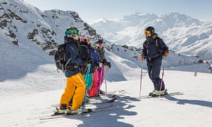 Women line up at the top of a run at a ski camp, Verbier, France.