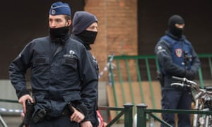 Belgian security forces seal off an area during an anti-terror operation in Molenbeek.