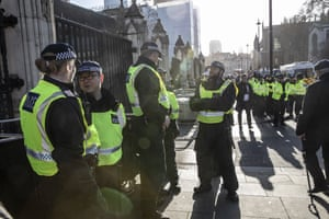 Police officers outside the Houses of Parliament in London, UK