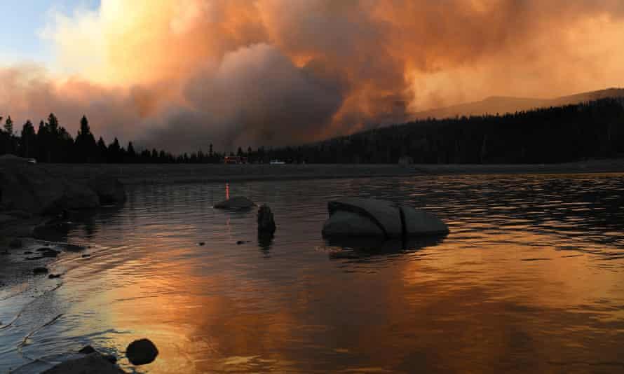 The Caldor fire is reflected off of Caples Lake near Kirkwood ski resort on Wednesday.