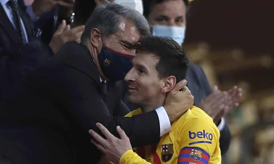 Lionel Messi gets a hug from Joan Laporta after Barcelona won the Copa del Rey last month.