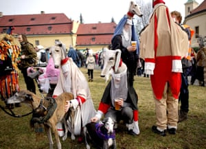 People wearing masks and costumes in Roztoky, Czech Republic