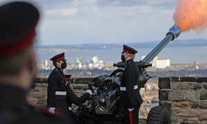 A handout photo made available by the British Ministry of Defense shows a gun salute at Edinburgh Castle