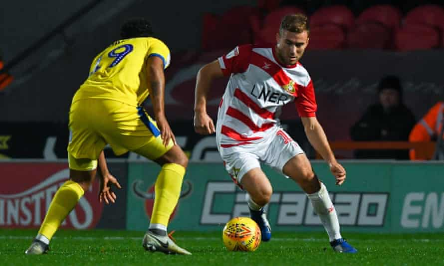 Herbie Kane, here taking on AFC Wimbledon, has scored four goals in his past four games for Doncaster, on loan from Liverpool.