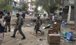 Afghan security forces at the scene of Saturday's suicide bomb in Jalalabad.