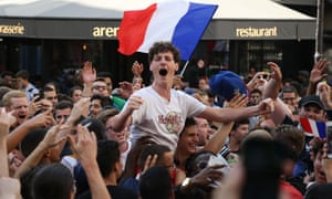 French supporters celebrate in Paris, on July 6, 2018, after France defeated Uruguay to win the quarter-final of the Russia 2018 World Cup.