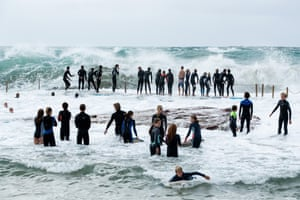 Dozens of teenagers gather at South Curl Curl ocean pool.
