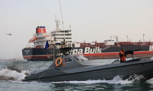 Speedboats from Iran's Revolutionary Guards seen with the British-flagged tanker Stena Impero