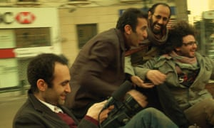 A scene of Khalid filming his friends in a downtown street