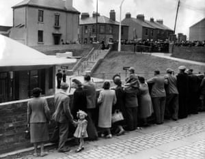 July 1951. The public looks on