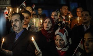 People hold candles at vigil in Cairo