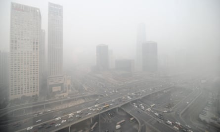 Buildings in Beijing are blanketed in heavy smog in January 2014, when the municipal government issued a yellow smog alert with air quality readings reaching the most polluted level.