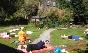 cloona yoga class on grass outside house