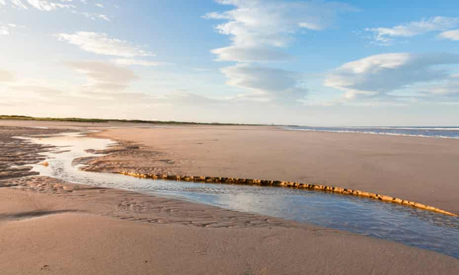 Tide ebbing on an empty beach at Gibraltar Point, Lincolnshire