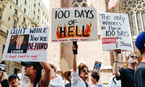 People protest outside Trump Tower on Fifth Avenue during the '100 Days of Failure' protest in New York, New York, on Saturday.