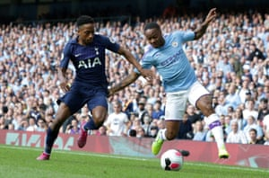 Manchester City midfielder Rahim Sterling (right) vies with Tottenham defender Kyle Walker-Peters.