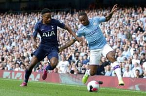 Manchester City's midfielder Raheem Sterling (R) vies with Tottenham Hotspur's defender Kyle Walker-Peters.
