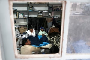 Rescued migrants wait in the coastguard's office in Rhodes.