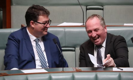 Barnaby Joyce talks to George Christensen on the backbench in the House of Representatives in Parliament House.