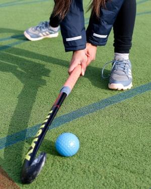 Kiran Kaur Gill playing hockey.