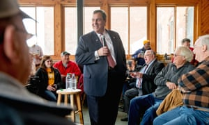 Chris Christie smiles as he jokes with visitors to Elly's Tea and Coffee House in Muscatine, Iowa, on Tuesday.