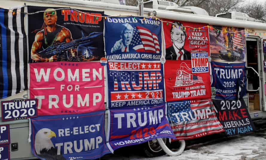 Flags for sale before a Trump rally.