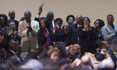 St. Jude classmates of Gregory Gunn stand during the funeral service for Gregory Gunn at True Divine Baptist Church in Montgomery, Ala., Saturday, March 5, 2016. Gregory Gunn was fatally shot by Montgomery Police Officer Aaron Smith on Feb. 25. Smith has been arrested. (Albert Cesare/The Montgomery Advertiser via AP) MANDATORY CREDIT
