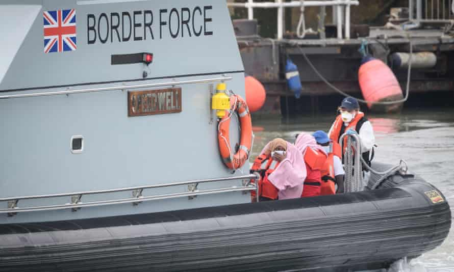 Asylum seekers arrive in Dover onboard a Border Force vessel after being intercepted while crossing the Channel