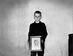 Freddy Childers ... 'Self-portrait with the picture of my biggest brother, Everett, who killed himself when he came back from Vietnam.'
