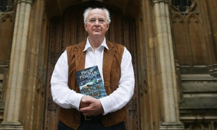 Darkness ahead … Philip Pullman poses with a copy of La Belle Sauvage: The Book of Dust Volume One.