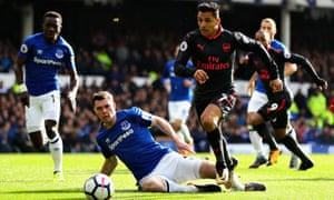 Alexis Sanchez of Arsenal runs past Michael Keane of Everton at Goodison Park on 22 October.