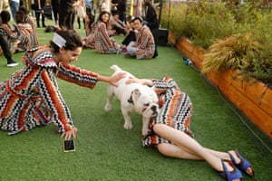 Models play with a dog backstage at the Missoni Spring/Summer 2020 show at fashion week