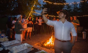 Michigan Democratic gubernatorial candidate Abdul El-Sayed of Detroit, goes live on Facebook during a campaign cookout.