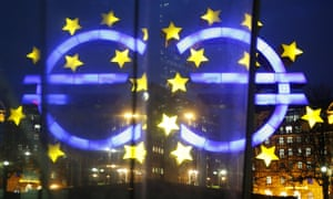 The Euro sculpture in front of the old headquarters of the European Central Bank is reflected in a glass plate in Frankfurt, Germany, Tuesday, Jan. 27, 2015. (AP Photo/Michael Probst)