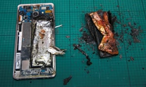 A Samsung Note 7 handset is pictured next to its charred battery after catching fire during a test at the Applied Energy Hub battery laboratory in Singapore. The company has now suspended production of the phone.