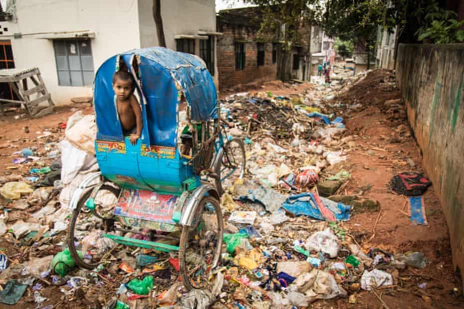 A rubbish-strewn street in Dhaka