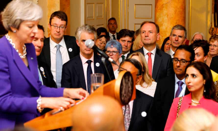 Simon Stevens (centre right) listens to Theresa May at a No 10 reception to mark the 70th anniversary of the NHS.