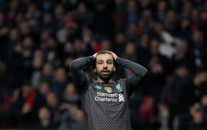 Salah reacts after a missed chance.
