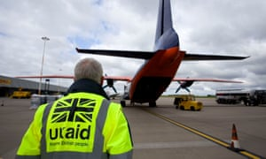 staff from UK Aid watch as cargo is loaded on to an Antonov An-12B aircraft at East Midlands Airport as part of the UK Government's humanitarian response to the crisis in Iraq. Britain has hit the United Nations target of spending 0.7% of national income on aid for the third year in succession, according to figures from the Department for International Development. PRESS ASSOCIATION Photo. Issue date: Thursday November 17, 2016. Annual statistics released by DFID showed that the £12.1 billion of overseas development aid in 2015 represented exactly 0.7% of the UK's gross national income (GNI). See PA story POLITICS Aid. Photo credit should read: Simon Cooper/PA Wire
