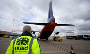 Staff from UK Aid watch as cargo is loaded on to an aircraft at East Midlands Airport as part of the UK Government's humanitarian response to the crisis in Iraq
