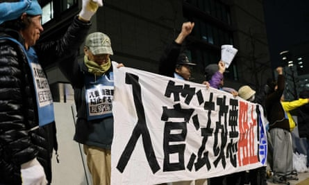 People stage a rally in Tokyo against a bill to allow more foreign workers in front of parliament.