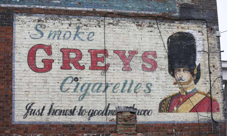 The Greys Cigarettes advert that sits below a Bovril ghost sign on a building in Bedford.