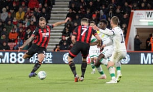 Steve Cook (left) scores Bournemouth's winning goal against Norwich.