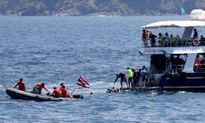 Thai navy and rescue workers search for survivors.